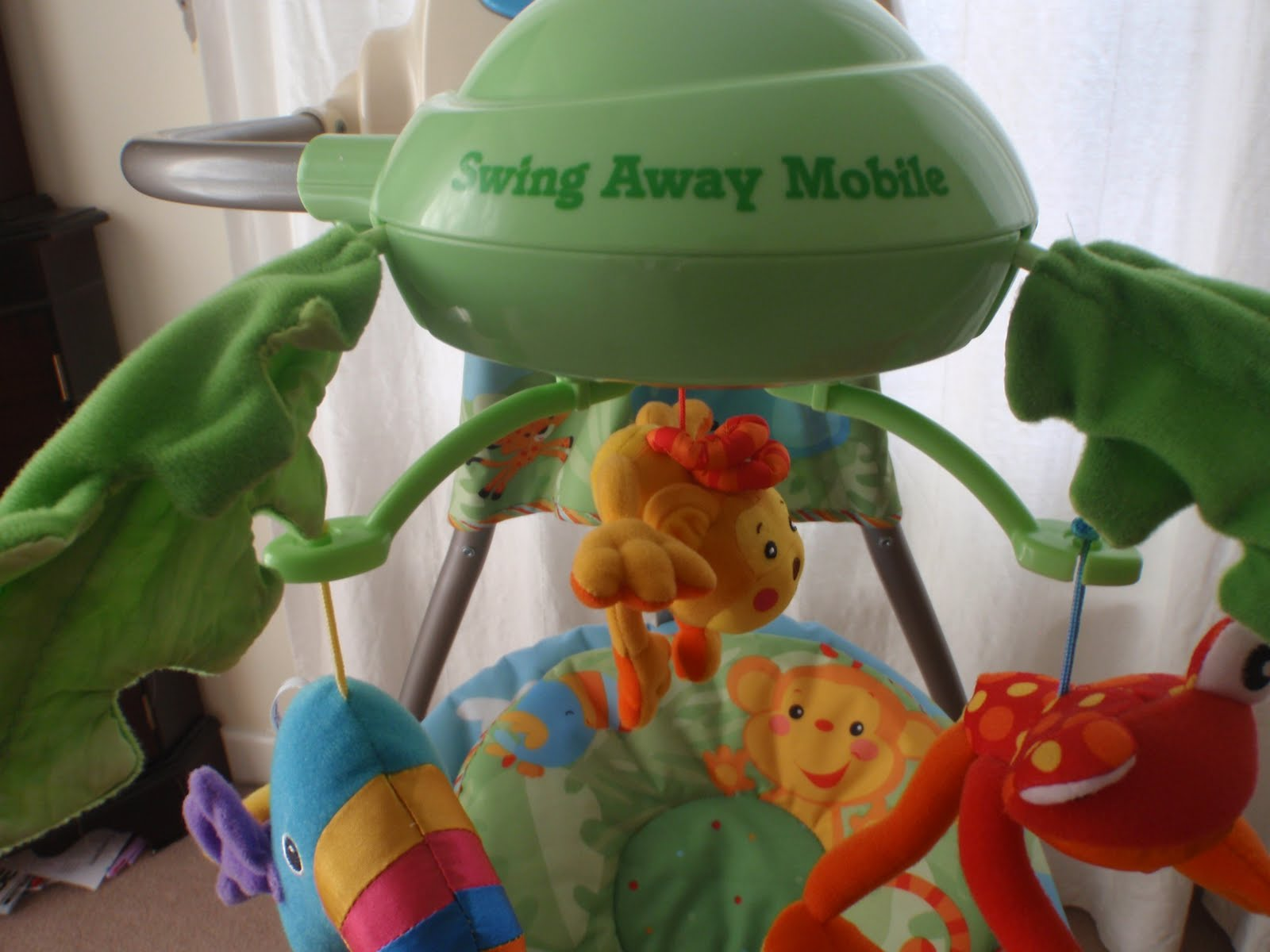 fisher price rainforest swing instructions