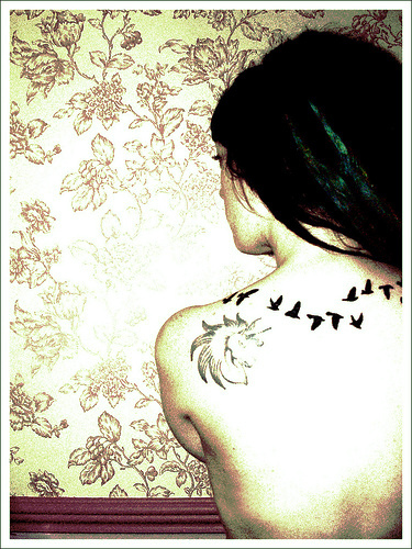 love bird tattoos. How about a tattoo of a. I want something like this only