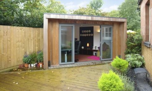 an idyllic garden office with fully glazed aspect to the rising sun and a golden view of the top of the tallest doric column in the world and with a big garden office ian