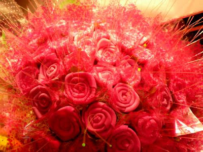Image of a bouquet of roses, made from some foamed plastic, with glowing snippets of fibre optic cable sticking out. This image is titled 'Alien Bouquet hot from Victoria Park's Chinese New Year Fair (Hong Kong, 2010)'