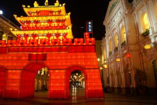 Image of a brightly lit guardhouse constructed from fabric and placed in Macau's old quarter
