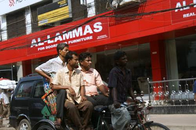 Three larger gentlemen sharing a rickshaw ride to save money