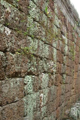 Image of a laterite wall at the Ta Prohm complex built by King Jayavarman VII (1181-1220).