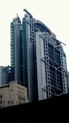 Image of HSBC's (Hong Kong Shanghai Banking Corporation's) flagship headquarters and banking centre in Hong Kong, seen towering over the old Bank of China headquarters beside it on the left of the picture.