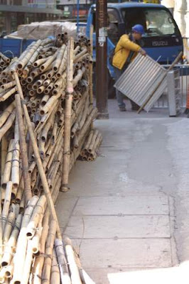 Another pile of cut bamboo lying on the sidewalk in Hong Kong.
