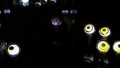 Image of a pond of eyes, at night; a public art installation outside the Sha Tin Town Hall in Sha Tin, Hong Kong.