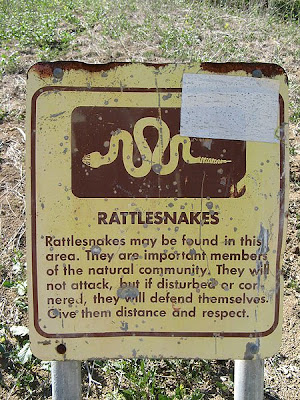 Image of a rattlesnake warning sign located in a park managed by county of Los Angeles, department of parks and recreation (sic). Photographed and uploaded by user:Geographer. This work is licensed under the Creative Commons Attribution 2.5 License and was sourced from Wikimedia.
