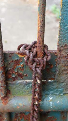 Image of a chain on the gate of a Buddhist monastery in Hong Kong's New Territories.