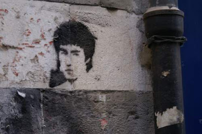 Graffiti image of Bruce Lee from the old town centre of Genoa, Italy.