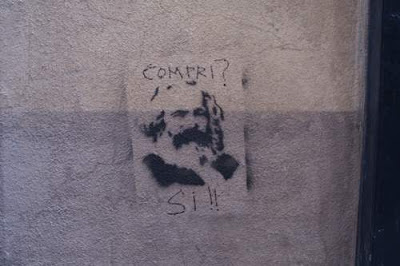 Graffiti image of Karl Marx from the old town centre of Genoa, Italy.