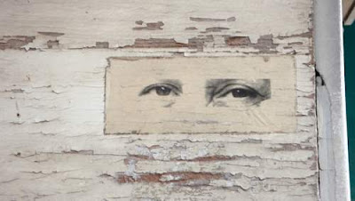 Graffiti image of eyes, alone, looking down from a wall in Venice, Italy.