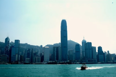 Image of 2IFC (International Finance Centre Two) on Hong Kong Island, seen from the water dwarfing the neighbouring buildings.