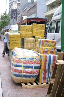 Image of a larger pile of goods for shipment, created by grey-market factories in Chungking Mansions, in Hong Kong.