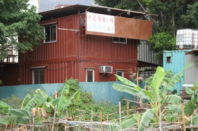 Image of a two-story walk-up container unit with shade and a back yard (in Tuen Mun, Hong Kong). Perfect for growing families. Must be seen to be believed.