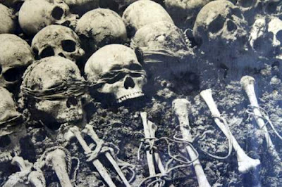 Image of bound bones and skulls with the blindfolds still fastened around them, from the genocide in Cambodia.