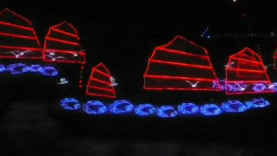 Image of a neon-lit 'Chinese Junk' on the water for the opening of the 2009 East Asian Games in Hong Kong