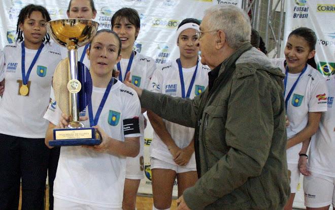 Brazil Futsal President Aecio Borba presents the Cup to Balneario Camboriu futsal team Capitan Gaby