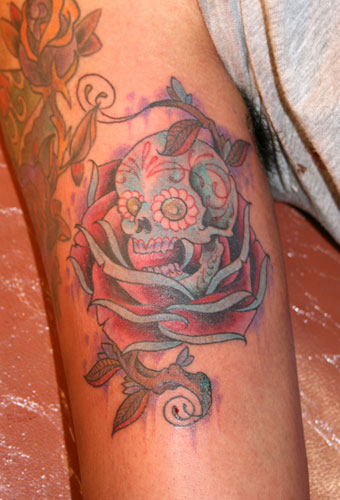 skull tattoo with flowers. I'm looking for girly skull tattoos or a drawing, I hope that one of you can