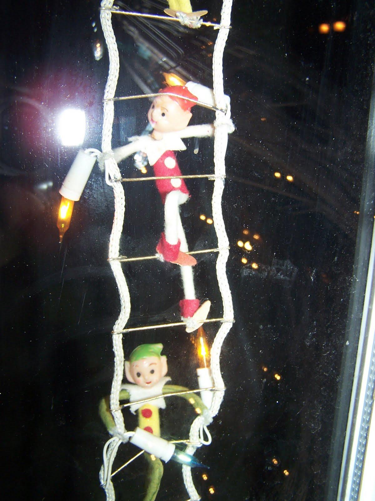 ladder climbing ornament elf.