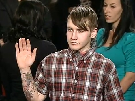 He's explaining to Judge Judy that his own hand tattoo is pending completion