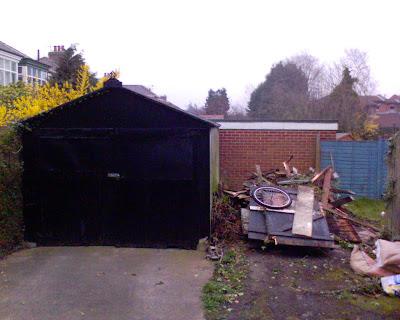 Wooden garage is demolished