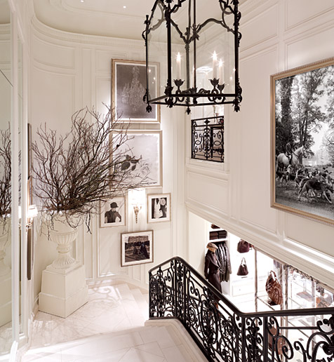 First Of All, The White Marble Entrance And Staircase Flanked By The  Wrought Iron Black Railing And Accented With The Iron Lantern And Black U0026  White Artwork ...