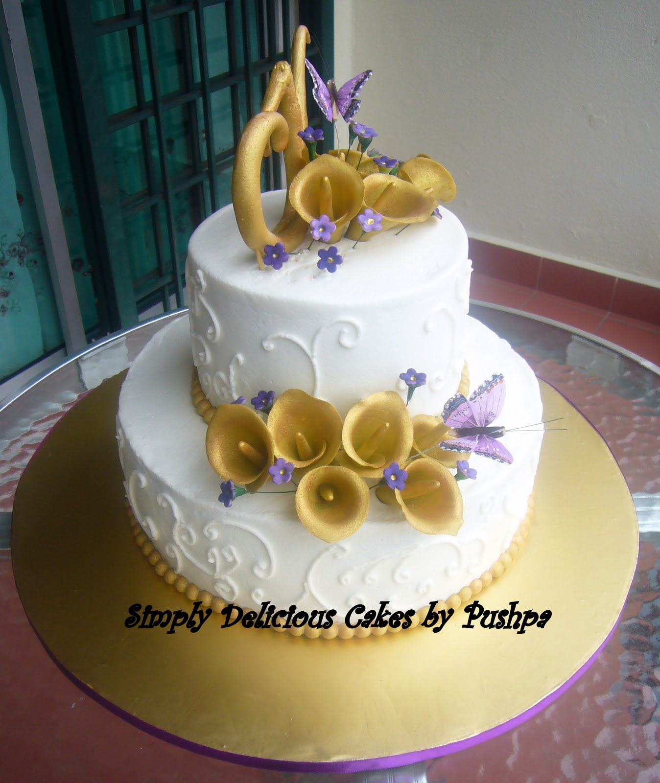 SIMPLY DELICIOUS CAKES Gold and Purple 2 Tier Cake