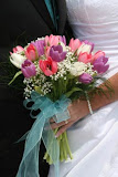 Beauty color purple, pink and white tulips with flower hand tied bouquet