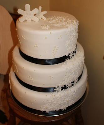 Snowflake wedding cake with black ribbon
