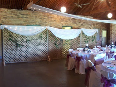 With fabric draping and Ivy around the lattice work