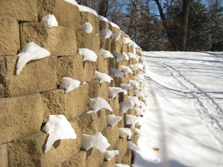 snow melting off bricks
