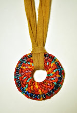 macrame circle with beads on linen