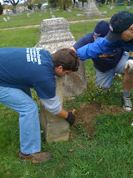 volunteers picking up headstones