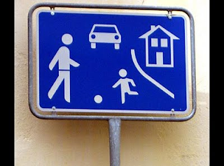 confusing sign with child, ball, house and adult