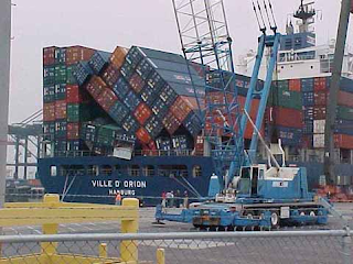 stacks of shipping containers fall over