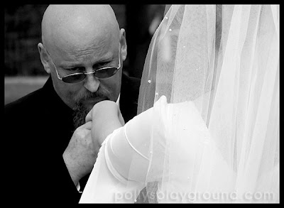 groom kissing brides hand