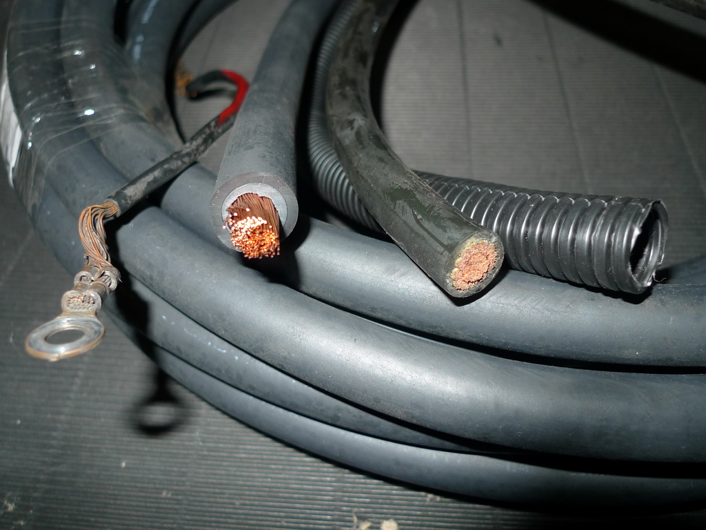From the left: Original ground cable, chemical resistant AWG 0 cable,  normal car audio power cable AWG 0, 16mm conduit.