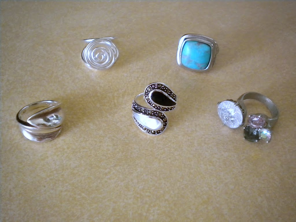Clockwise From Top Left: 1) Sterling Silver Spiral Ring  Kohl's (gifted)  2) Turquoise Square Ring  The Limited 3) Multicolored Stone Ring  Banana