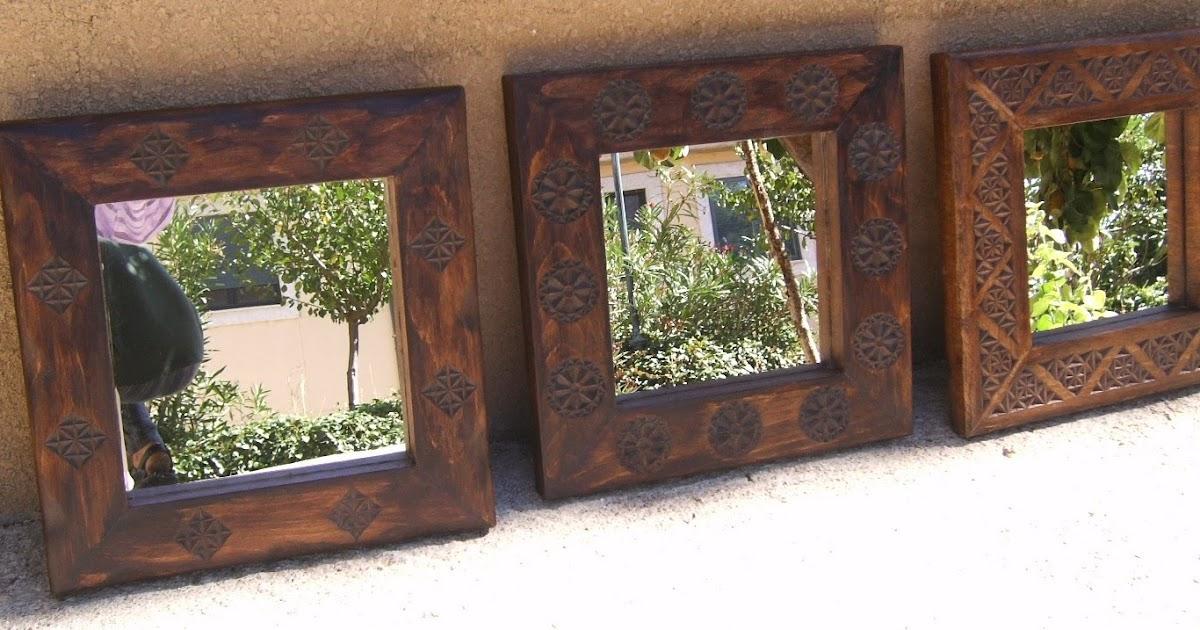 Artesan a tope y cu a espejos con marco de madera tallada for Disenos de espejos tallados en madera