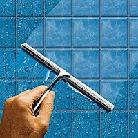 Squeegee Your Shower To Lower Humidity, Lower Cooling Bills & Make Your Wife