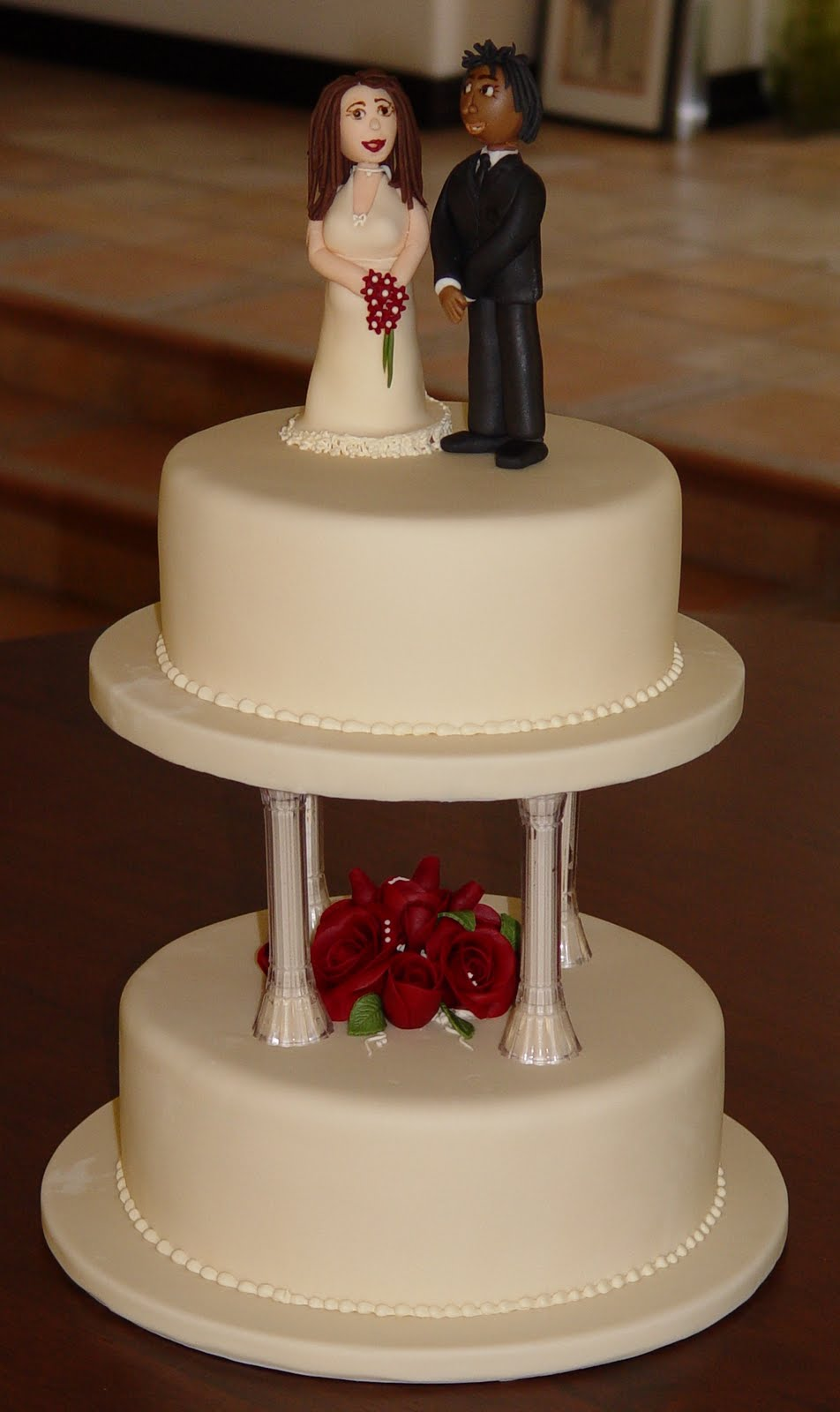 let them eat cake cream two tire wedding cake with figures. Black Bedroom Furniture Sets. Home Design Ideas