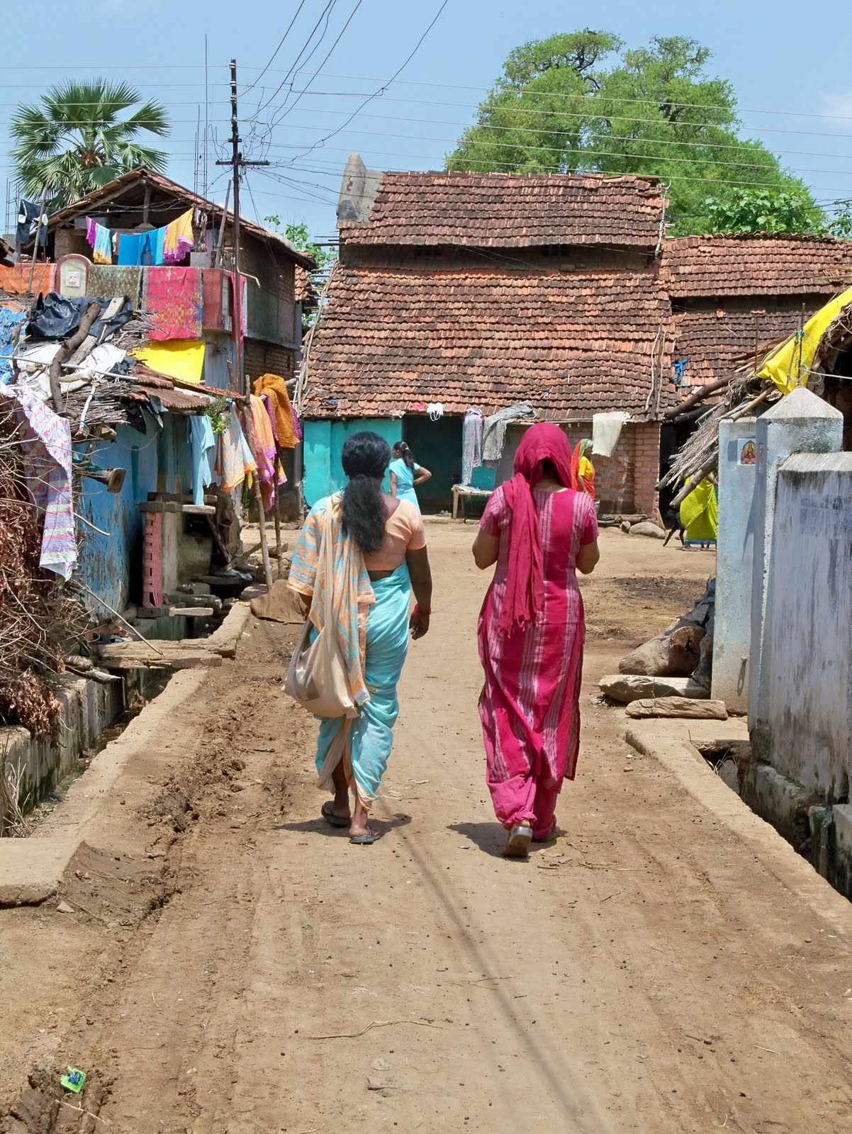 Anjana (the village health worker) and Bhagyashree leading the way to