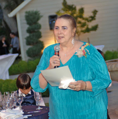 Mother of the groom reads her poem