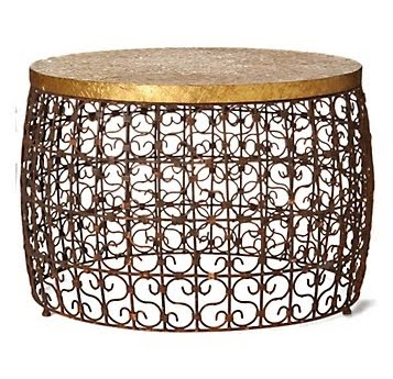 Iron drum coffee table with coils topped with an embossed brass top