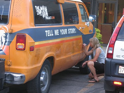 Participant writing her recession story on the van