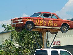 old red car on pole