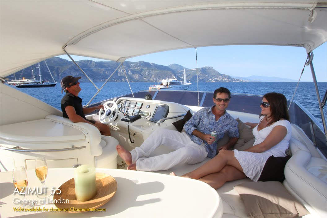 Azimut 55 at anchor near Villefranche Guests relax near Paloma Beach St Jean ...