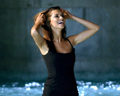Model Adriana Lima gets wet