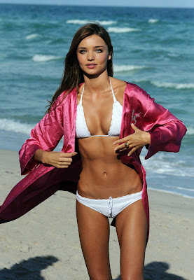 Model Miranda Kerr in a white bikini