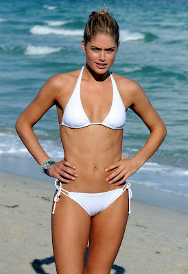 Model Doutzen Kroes in a white bikini